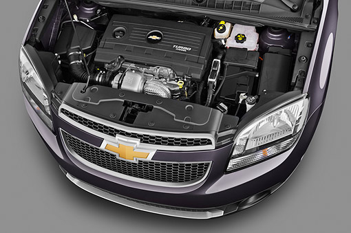 AUT 30 IZ1743 01 © Kimball Stock 2013 Chevrolet Orlando LTZ+ MPV Purple Engine Detail In Studio