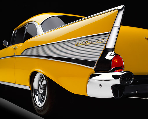 AUT 30 RK0031 03 © Kimball Stock 1957 Chevy Bel Air Yellow Low Side Rear Tail Fin On Yellow Floor Studio Background Brake Lights On