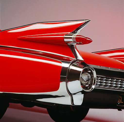 AUT 30 RK0110 05 © Kimball Stock 1959 Red Cadillac Eldorado Convertible Detail Tailfin View Showing Grill And Brake Lights