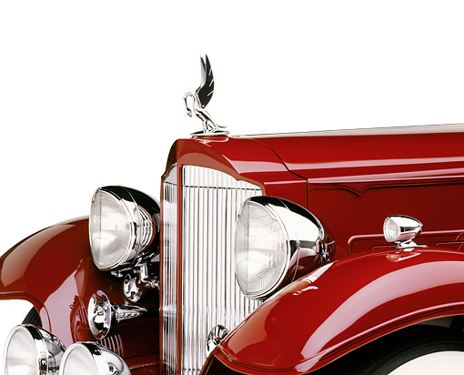 AUT 30 RK0293 04 © Kimball Stock Detail Shot Of Front Hood Grill Lights And Emblem Of A 1933 Packard Convertible CP Burgundy White Seamless