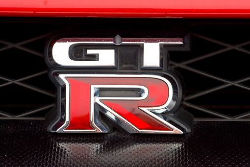 AUT 30 RK4769 01 © Kimball Stock 2010 Nissan GT-R Red Emblem Detail Studio