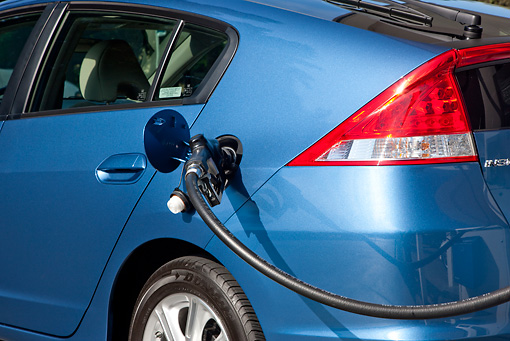 AUT 30 RK4935 01 © Kimball Stock 2010 Honda Insight Blue Detail At Gas Station