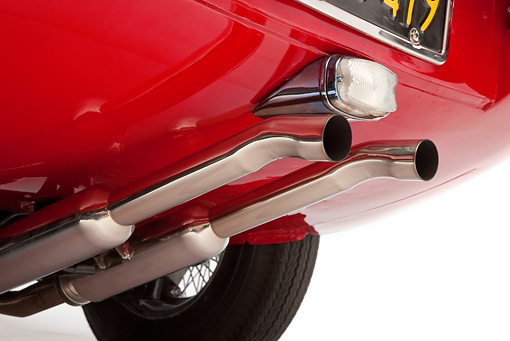 AUT 30 RK5118 01 © Kimball Stock 1966 Jaguar XKE Coupe Red Exhaust Detail Studio