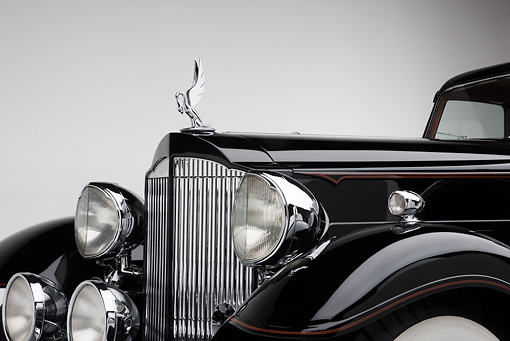 AUT 30 RK5123 01 © Kimball Stock 1933 Packard Twelve Custom Dietrich Coupe Black Front Detail On White Seamless