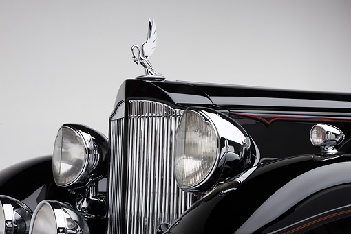 AUT 30 RK5124 01 © Kimball Stock 1933 Packard Twelve Custom Dietrich Coupe Black Front Detail On White Seamless