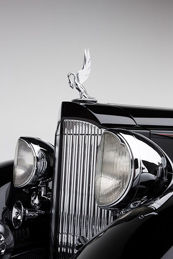 AUT 30 RK5126 01 © Kimball Stock 1933 Packard Twelve Custom Dietrich Coupe Black Front Detail On White Seamless