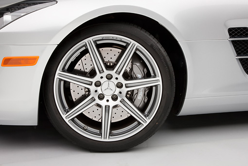 AUT 30 RK5248 01 © Kimball Stock 2011 Mercedes-Benz SLS AMG Silver Front Wheel Detail In Studio