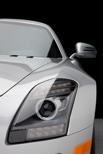 AUT 30 RK5249 01 © Kimball Stock 2011 Mercedes-Benz SLS AMG Silver Headlight Detail In Studio