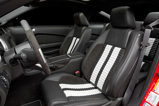 AUT 30 RK5637 01 © Kimball Stock 2011 Shelby Ford Mustang GT500 SVT Red With White Stripes Interior Detail In Studio