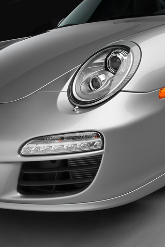 AUT 30 RK5661 01 © Kimball Stock 2011 Porsche 911 Carrera GTS Silver Headlight Detail In Studio