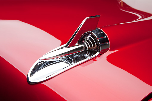 AUT 30 RK5704 01 © Kimball Stock 1957 Chevrolet Bel Air Convertible Red Hood Ornament Detail In Studio