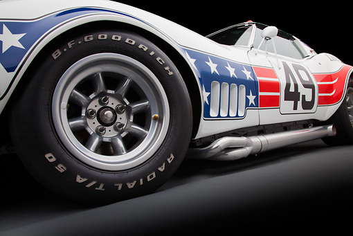 AUT 30 RK5720 01 © Kimball Stock 1969 Chevrolet Corvette BFG #49 ZL-1 Race Car Red, White And Blue Front Wheel Detail In Studio