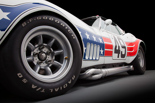 AUT 30 RK5721 01 © Kimball Stock 1969 Chevrolet Corvette BFG #49 ZL-1 Race Car Red, White And Blue Front Wheel Detail In Studio