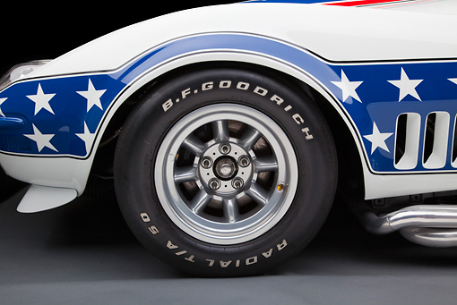 AUT 30 RK5722 01 © Kimball Stock 1969 Chevrolet Corvette BFG #49 ZL-1 Race Car Red, White And Blue Front Wheel Detail In Studio