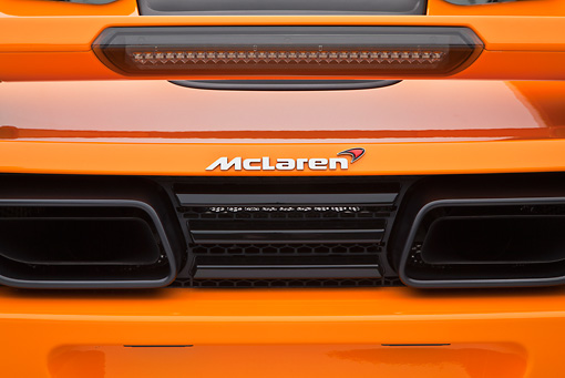 AUT 30 RK5950 01 © Kimball Stock 2012 McLaren MP4-12C Orange Emblem Detail Studio