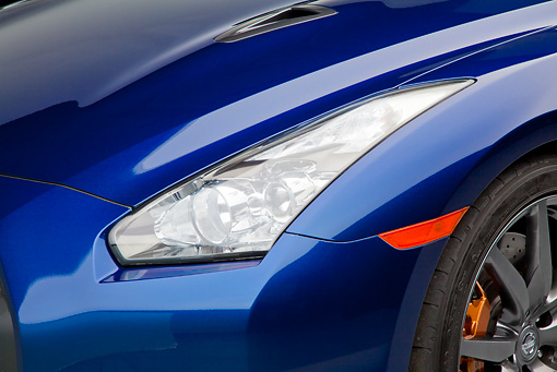 AUT 30 RK5960 01 © Kimball Stock 2012 Nissan GT-R Deep Blue Pearl Headlight Detail In Studio