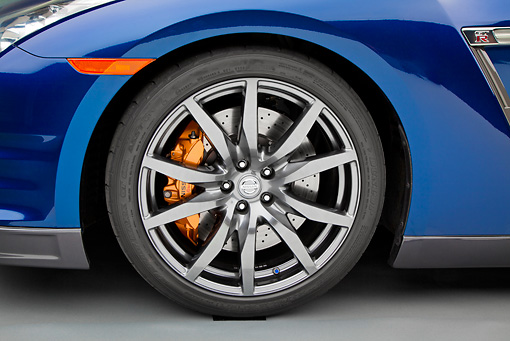 AUT 30 RK5961 01 © Kimball Stock 2012 Nissan GT-R Deep Blue Pearl Front Wheel Detail In Studio