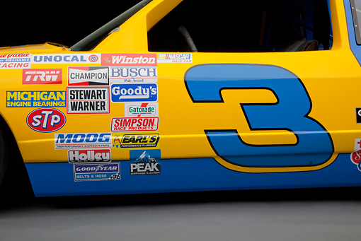 AUT 30 RK5982 01 © Kimball Stock 1987 Chevrolet Monte Carlo Stock Car Blue And Yellow Side Detail In Studio