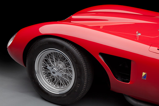 AUT 30 RK6031 01 © Kimball Stock 1957 Ferrari 625 TRC Red Front Wheel And Hood Detail In Studio
