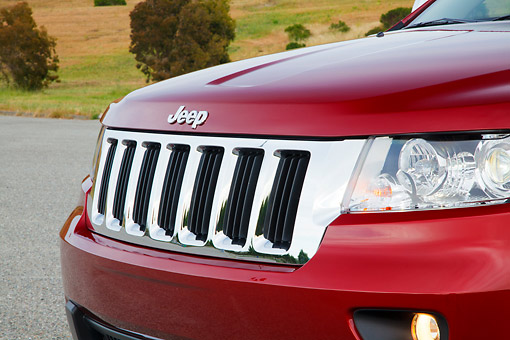 AUT 30 RK6079 01 © Kimball Stock 2012 Jeep Grand Cherokee Limited 4X4 Red Bumper And Headlight Detail