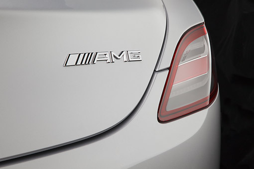 AUT 30 RK6113 01 © Kimball Stock 2012 Mercedes-Benz SLS Silver Logo Detail In Studio