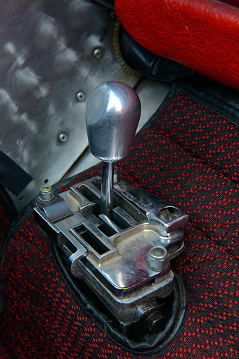 AUT 30 RK6226 01 © Kimball Stock 1970 Ferrari 312B Race Car Red Gear Shift Detail In Studio