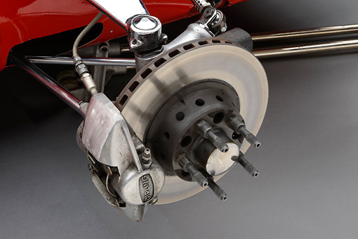 AUT 30 RK6227 01 © Kimball Stock 1970 Ferrari 312B Race Car Red Front Suspension Detail In Studio