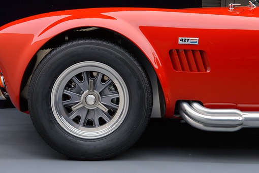 AUT 30 RK6229 01 © Kimball Stock 1966 Shelby AC Cobra Red With White Stripes Front Wheel Detail In Studio