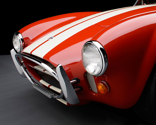 AUT 30 RK6230 01 © Kimball Stock 1966 Shelby AC Cobra Red With White Stripes Front Detail In Studio