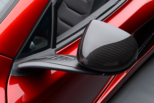 AUT 30 RK6261 01 © Kimball Stock 2013 McLaren MP4-12C Spider Red Side Mirror Detail In Studio
