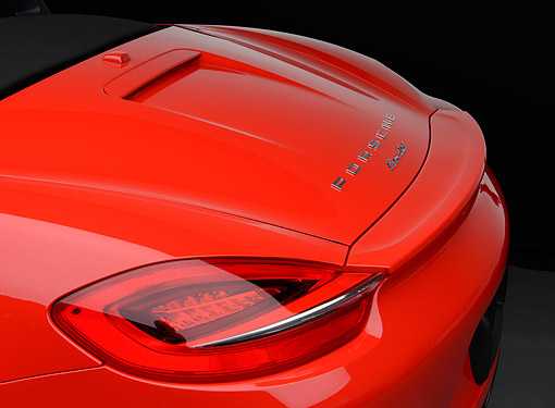 AUT 30 RK6287 01 © Kimball Stock 2013 Porsche Boxster Red Rear Detail In Studio