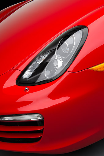 AUT 30 RK6290 01 © Kimball Stock 2013 Porsche Boxster Red Headlight Detail In Studio