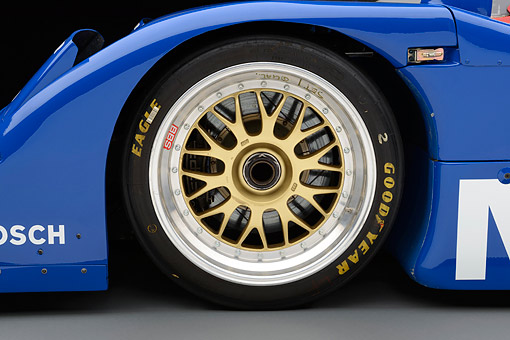 AUT 30 RK6292 01 © Kimball Stock 1992 Nissan GTP ZX-Turbo Race Car Blue And Red Front Wheel Detail In Studio