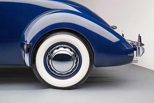 AUT 30 RK6326 01 © Kimball Stock 1937 Cord Supercharged 812 Phaeton Blue Rear Wheel Detail In Studio