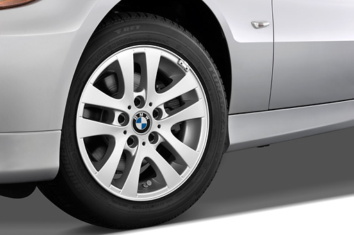 AUT 30 IZ0020 01 © Kimball Stock 2011 BMW 3 Series Station Wagon Silver Front Wheel Detail Studio