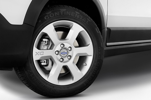 AUT 30 IZ0094 01 © Kimball Stock 2010 Volvo XC70 White Front Wheel Detail Studio