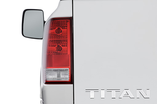 AUT 30 IZ0136 01 © Kimball Stock 2010 Nissan Titan SE Crew Cab Pickup Truck White Brake Light Detail Studio