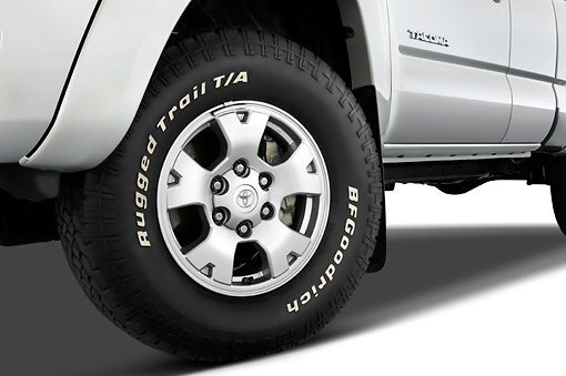 AUT 30 IZ0150 01 © Kimball Stock 2010 Toyota Tacoma Access Cab Pickup Truck Silver Front Wheel Detail Studio