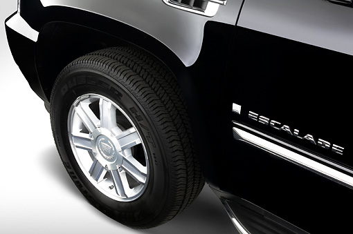 AUT 30 IZ0166 01 © Kimball Stock 2008 Cadillac Escalade EXT Pickup Truck Black Front Wheel Detail Studio