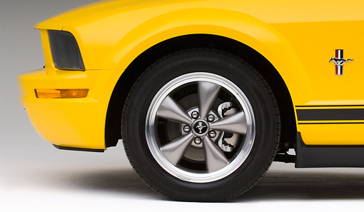 AUT 30 IZ0287 01 © Kimball Stock 2008 Ford Mustang V6 Pony Coupe Yellow Front Wheel Detail Studio