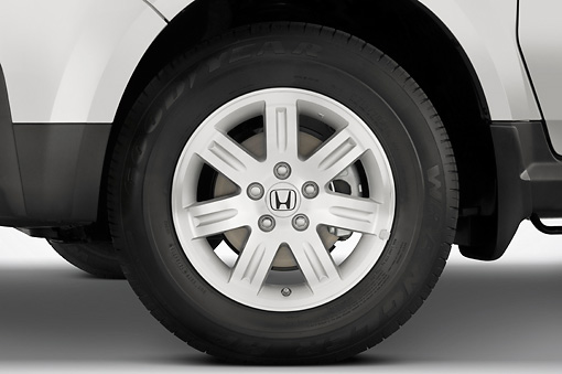 AUT 30 IZ0292 01 © Kimball Stock 2008 Honda Element Silver Front Wheel Detail Studio