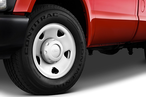 AUT 30 IZ0335 01 © Kimball Stock 2010 Ford F-250 Red Front Wheel Detail Studio