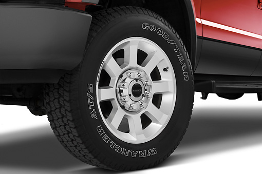 AUT 30 IZ0349 01 © Kimball Stock 2010 Ford F-250 Crew Cab Red Front Wheel Detail Studio