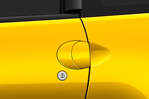 AUT 30 IZ0569 01 © Kimball Stock 2009 Mitsubishi Eclipse GT Coupe Yellow Door Handle Detail Studio