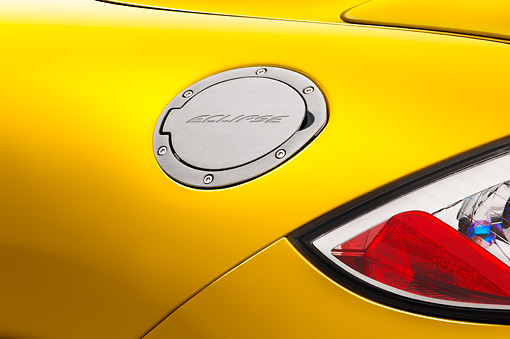 AUT 30 IZ0571 01 © Kimball Stock 2009 Mitsubishi Eclipse GT Coupe Yellow Gas Door Detail Studio