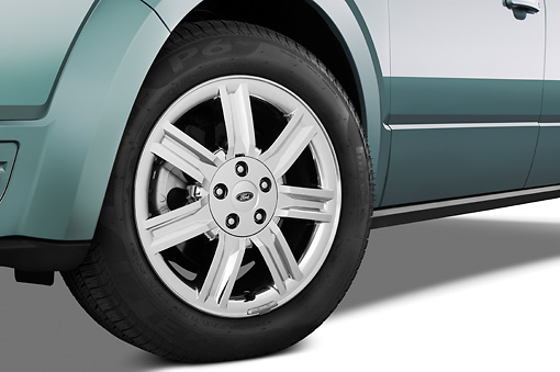 AUT 30 IZ0682 01 © Kimball Stock 2009 Ford Taurus X Limited Green Front Wheel Detail Studio