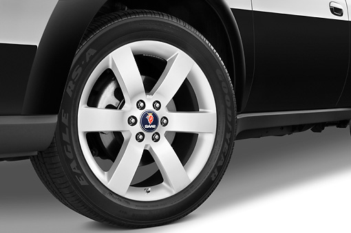 AUT 30 IZ0726 01 © Kimball Stock 2009 Saab 9-7X Aero Black Front Wheel Detail Studio
