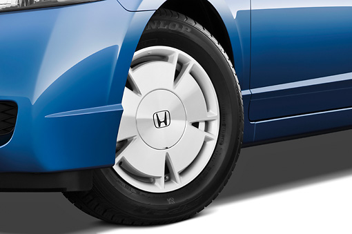 AUT 30 IZ0754 01 © Kimball Stock 2011 Honda Civic Hybrid Blue Front Wheel Detail Studio