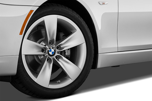 AUT 30 IZ0846 01 © Kimball Stock 2010 BMW 528i Silver Front Wheel Detail Studio