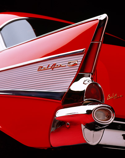 AUT 30 RK0030 03 © Kimball Stock 1957 Chevrolet Bel Air Red Close Up Low Rear Tailfin Studio Background